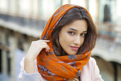 Close up portrait of a muslim young woman wearing a head scarf Stock Images
