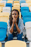 Close-up portrait of the nervous afro-american teenager worrying about the match on the stadium. Royalty Free Stock Photos