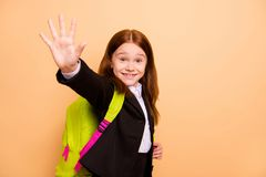 Close-up portrait of nice attractive lovely cheerful confident positive pre-teen girl learner wearing jacket blazer. Close-up portrait of nice attractive lovely stock image