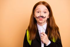 Close-up portrait of nice attractive lovely childish playful foolish pre-teen girl wearing jacket blazer fake mustache 1. Close-up portrait of nice attractive royalty free stock images