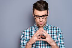 Close-up portrait of nice handsome attractive sad minded guy wearing checked shirt folded fingers thinking isolated over. Gray pastel background stock photos