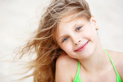Close-up Portrait of a nice little girl with waving in the wind Royalty Free Stock Images