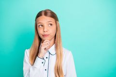 Close-up portrait of nice-looking attractive lovely girlish charming pensive minded clever smart pre-teen girl creating. Close-up portrait of nice-looking stock photo