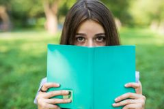 Free Close-up Portrait Of A Beautiful Young Woman With Book In The Park Royalty Free Stock Photo - 126301345