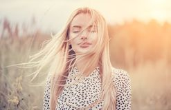Free Close Up Portrait Of Beauty Girl With Fluttering White Hair Enjoying Nature Outdoors, On A Field. Flying Blonde Hair On The Wind Royalty Free Stock Photo - 160366625