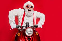 Free Close-up Portrait Of Nice Attractive Bearded Cheerful Cheery Glad Funny Funky Santa Riding Motor Bike Delivering Gifts Royalty Free Stock Photo - 161053705