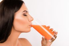Free Close Up Portrait Of Sexy Healthy Young Woman Drinking Juice Stock Images - 165361004
