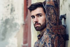 Free Close-up Portrait Of Young Bearded Man, Model Of Fashion, In Urban Background Wearing Casual Clothes. Royalty Free Stock Photography - 109114447