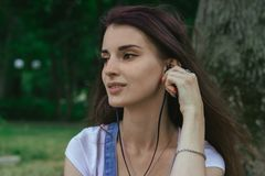 Close Up Portrait Of Young Brunette Girl Listening Music With Headphones Royalty Free Stock Photography
