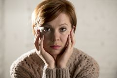 Free Close Up Portrait Of Young Sweet And Pretty Red Hair Woman Looking Sad And Depressed In Dramatic Face Expression Feeling Lonely Royalty Free Stock Photo - 105095655