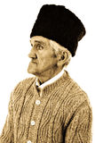 Close-up portrait of an old peasant man with wooly hat Royalty Free Stock Photo