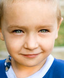 Close up portrait of one cute kid with nice eyes Stock Images