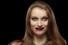 Close-up portrait of a pale gothic vampire woman. On a black background Royalty Free Stock Photography