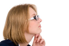 Close-up portrait of a pensive girl in profile. Royalty Free Stock Photography