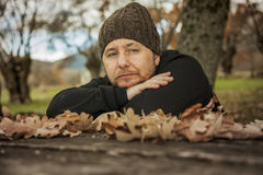 Close up portrait pensive man with sitting on a bench. Autumn le Royalty Free Stock Photo