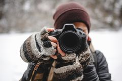 Close up portrait of photographer taking pictures with digital camera outdoor. Close up portrait of photographer taking pictures with digital camera. Outdoor in royalty free stock photo