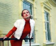 Close-up portrait posing girl in orange Royalty Free Stock Image