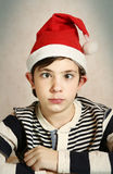 close up portrait of a preteen boy in santa hat Royalty Free Stock Image