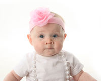 Close up portrait of pretty baby wearing pearls Stock Image