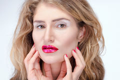Close-up portrait of a pretty blond girl with bright makeup. Fashion shoot Stock Photo