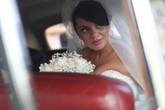 Close-up portrait of a pretty bride in a car window Royalty Free Stock Photos