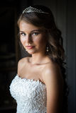 Close up portrait of pretty bride in hotel room Royalty Free Stock Photos