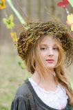Close up portrait of a pretty pensive girl in a folk circlet Royalty Free Stock Images