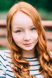 Close-up portrait of pretty smiling girl with curly red hair stock images