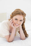 Close up portrait of a pretty woman in bed Stock Image