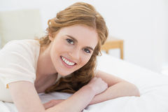 Close up portrait of pretty woman in bed Stock Photos