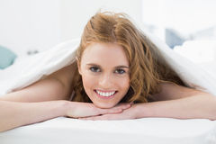 Close up portrait of a pretty woman in bed Stock Photography