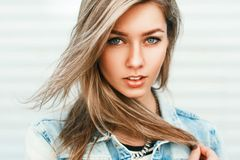 Close up portrait of a pretty woman from Europe in a denim jacke. T. summer Stock Photography