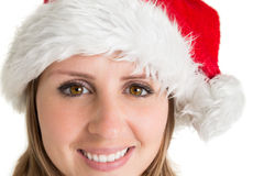 Close up portrait of pretty woman in santa hat Royalty Free Stock Images