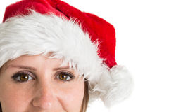 Close up portrait of pretty woman in santa hat smiling Royalty Free Stock Photography