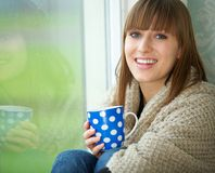 Pretty Woman Smiling with Cup of Tea Stock Photo
