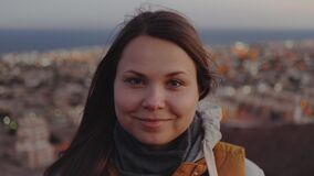 Close up portrait of pretty woman smiling at sunset sea and small Arabic village background, Egypt, slow motion, 4k
