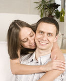 Close up portrait of pretty young couple. man and woman hugging Stock Image