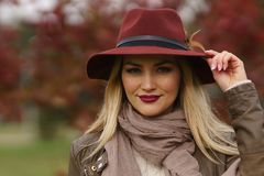 Beautiful blonde girl walking in the park royalty free stock photos