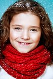 Beautiful young girl. A close-up portrait of a pretty young girl wearing a sweater and a scarf. Winter fashion for kids, beauty royalty free stock photos