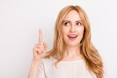 Close up portrait of pretty young smiling lady pointing up isol royalty free stock photography