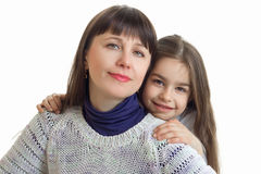 Close-up portrait of a pretty young woman and little girl Royalty Free Stock Photos