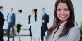 Portrait of a business woman looking happy and smiling Royalty Free Stock Images