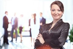 Portrait of a business woman looking happy and smiling Royalty Free Stock Photo
