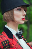 Close-up portrait in profile of beautiful young woman in horsewo Royalty Free Stock Photo