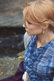 Close-up portrait in profile of woman in retro style outdoor Stock Image