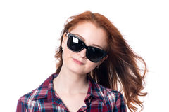 Close-up portrait of a red-haired beautiful woman wearing sunglasses Stock Photography