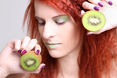 Close up portrait of redhaired girl with kiwi Stock Photography
