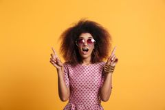 Close-up portrait of retro stylish amazed african wooman in sung Stock Photo