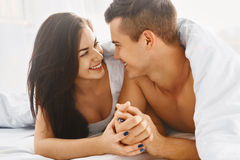 Close up portrait of romantic couple in bed Royalty Free Stock Photos