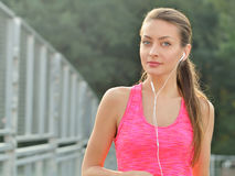 Close up portrait of running fitness woman Royalty Free Stock Photo